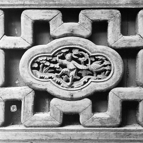 parapet with traditional folklore wood carvings