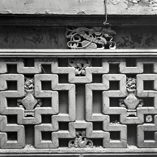 parapet with antique wooden hand-carved motifs