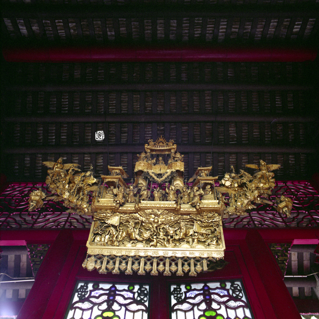 gilded wood carving of the Heavenly Palace