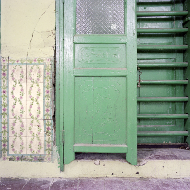 glazed and patterned tiles, floral carvings on pintu pagar, tanglong door